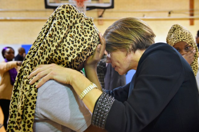 """(01/30/17 Dorchester, MA) Somalian twins, Muna and Muniira Abdi, 12 are reassured by Attorney General, Maura Healey they are protected as American citizens here in Boston. Maura Healey talks to  Muna as she starts to cry. The twins expressed their fear in recent events and asked Healey, """" What are you doing to make us feel like Americans too?""""  during the announcement program of  a new youth anti-gun violence program with Boston Public School leaders and local officials at the Martin Luther King Jr k-8 Inclusion School.  January 30, 2017"""