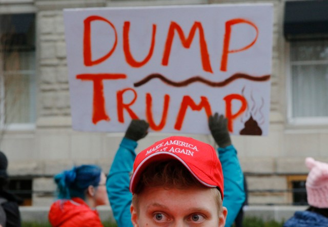A supporter of U.S. President Donald Trump talks to opponents during the Women's March on Washington in Washington, DC, U.S. January 21, 2017.