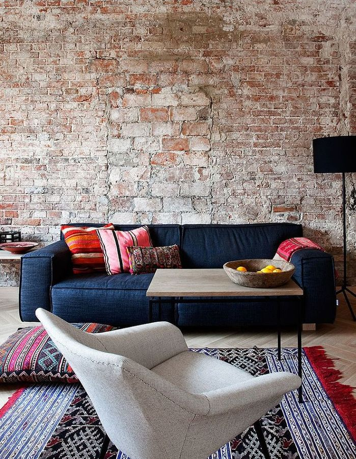 Plain sofa with patterned rug