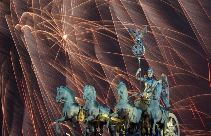 """Celebrating New Year 2014-Berlin_ Germany- Fireworks illuminate the night sky over the Brandenburger Tor"""