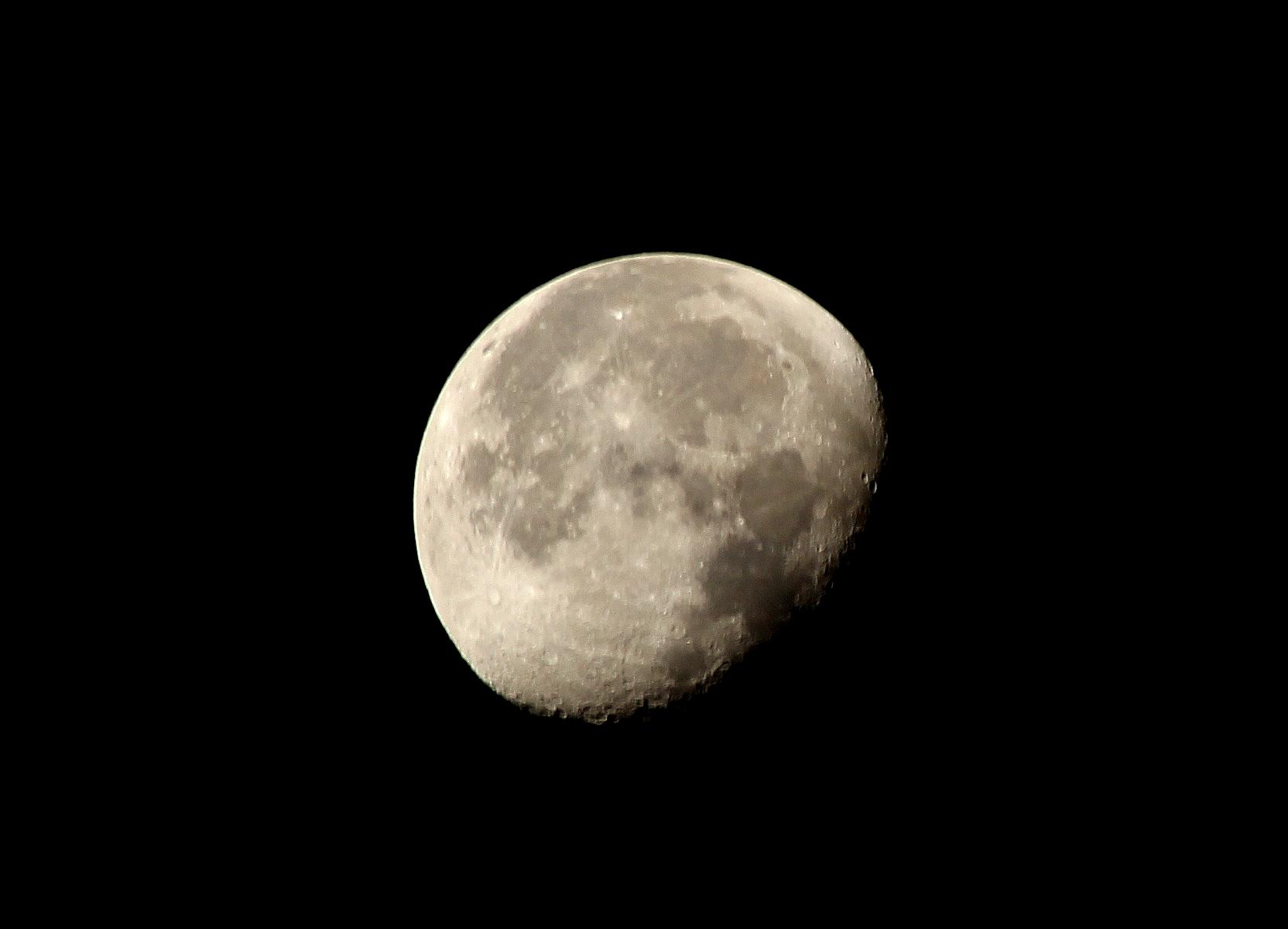 three quarter moon in night sky