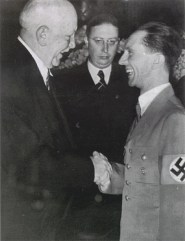 The head of the Nazi Party's Bureau of Music, Richard Strauss (left) pretending to be pleased with the equally false Head of Nazi Propaganda, Josef Goebbels (right).