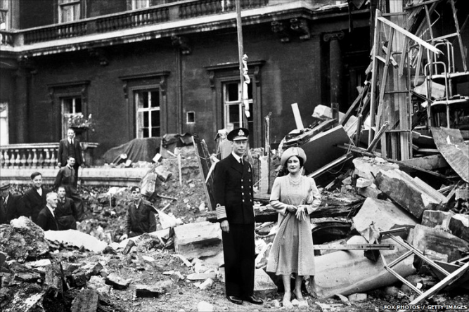 """Despite being the last person expected to rule England, George did so with a sense of brave nobility befitting a King. The Royal Family refused to leave their people during the War, standing firm amidst the worst of Nazi """"blitz"""" bombings, as can be seen with ruins of the west wing of their own residence, Buckingham Palace, after being hit in September of 1940. (wikipedia.org)"""