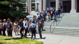 The Davis Dozen and supporters exit the Yolo County Courthouse