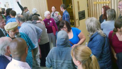 Santa Cruz Eleven and Supporters Exit Courtroom