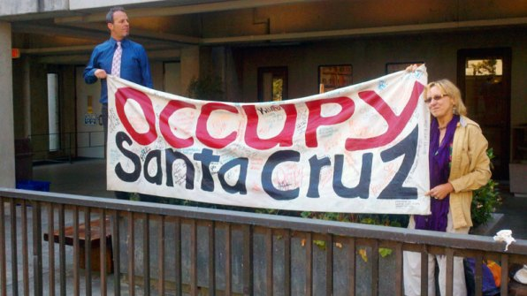 Brent Adams and Coral Brune Display Occupy Santa Cruz Banner