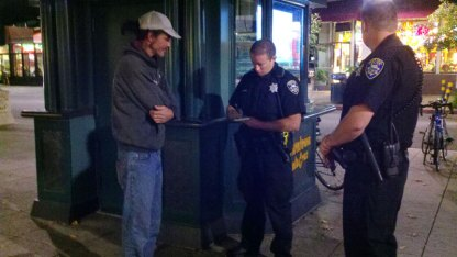 SCPD officer Brian Warren writes a ticket for smoking.
