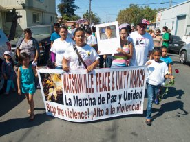 A photo of Richard Eddie Campos (2/26/88 - 9/13/09), who was killed on the evening of Tuesday, September 13, 2009 while sitting in his car on Roache Road in Watsonville, is held up at the front of the annual Peace and Unity March in Watsonville, CA.