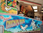 the only customers in the KFC suggested that I take a phone of this pinball-type game showing the Colonel chasing after a chicken with a stick in his hand