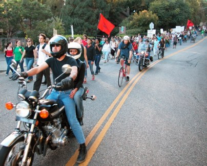coming down Laurel St. with biker protection