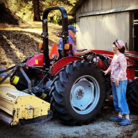 Blaize greets Farmer Bill at his orchard in Soquel