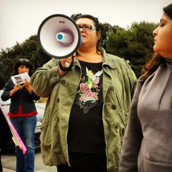 """Angélica Garza, Frank Alvarado's sister, speaking at the rally on July 12 in East Salinas against police violence and to demand justice for her brother Frank. Angélica said she was born in Watsonville and Frank was born in Salinas. """"I want justice for Frankie ... He had a big heart ... I want to thank every single one of you from the bottom of my heart."""""""