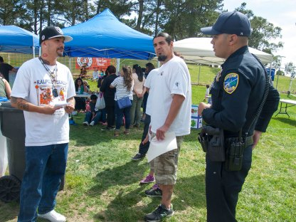 A Watsonville Police officer asked what was going on and said he was not familiar with the Driscoll's boycott. Michael Garcia of the Watsonville Brown Berets provided the officer with an overview of the issues. It was a friendly interaction with the officer.