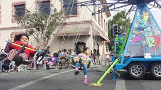 Children ride the Cyclone at the Watsonville Strawberry Festival on August 6, 2016.