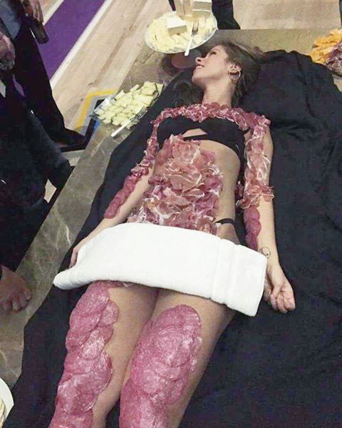 A woman was treated like a piece of meat at the Altai Brands after-party in Las Vegas, Nevada on November 17, 2016. Photo by Adam Mintz via social media.