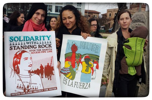 Vera and Liz in Watsonville Plaza. La Mujer Es La Fuerza. Solidarity with Standing Rock.