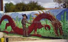 Broadway and Alvernon dragon and cowboy painting