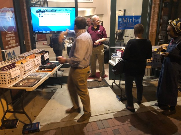 I did go check out First Thursday later. That's Kyle in the doorway in he garnet shirt. That's ex-Rep. Boyd Brown in the foreground with his head turned back.