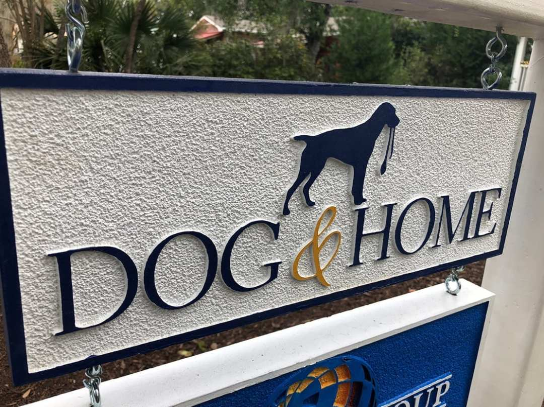 A sign for Dog & Home pet boutique in Old Town Bluffton SC