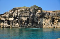 Get a dose of adrenaline-pumping excitement from jumping off this 20-foot (thereabouts) cliff of Iniwaran Island