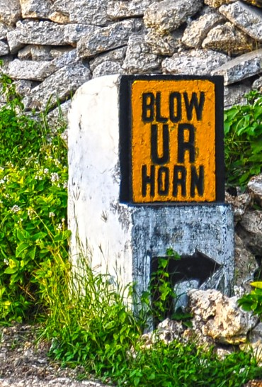 "This ubiquitous road sign is spread across Batanes' National Highway system, a reminder to motorists to not forget to honk when navigating the meandering roads of Batanes. What makes this sign unique is that, as related by a local resident, the sign user ""UR"" for YOUR, years before text-speak reached the region."