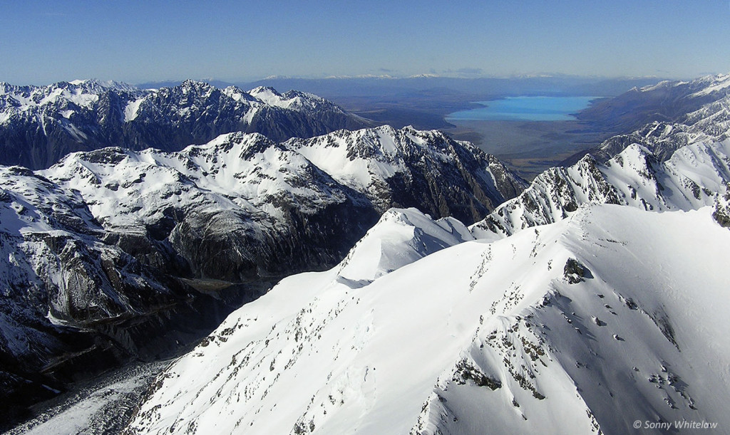 The headwaters of the Waitaki River in the Southern Alps Kä Tiritiri o te Moana. Aoraki Mt Cook (centre and lower right), Tasman glacier (bottom left) with the Tasman River flowing into Lake Pukaki (right background)