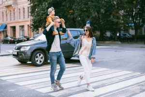 Young Family of three walking in crosswalk