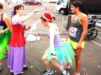 Getting some pixie dust from a fairy godmother after crossing the finish line.