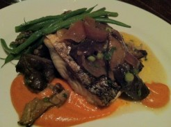 Grilled wild striped bass with lentil ragout, red pepper puree and dried apricots. Shiitake mushrooms and clam salsa