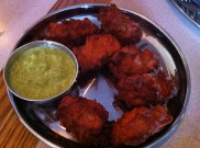 Onion Bhazi - Onions fried with chick pea flour and garnished with spices