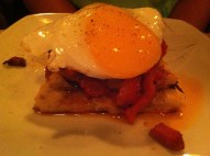 Potato Tart with chorizo and roasted peppers topped with a fried egg