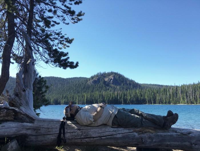 Michael taking a nap on a log by Doris Lake