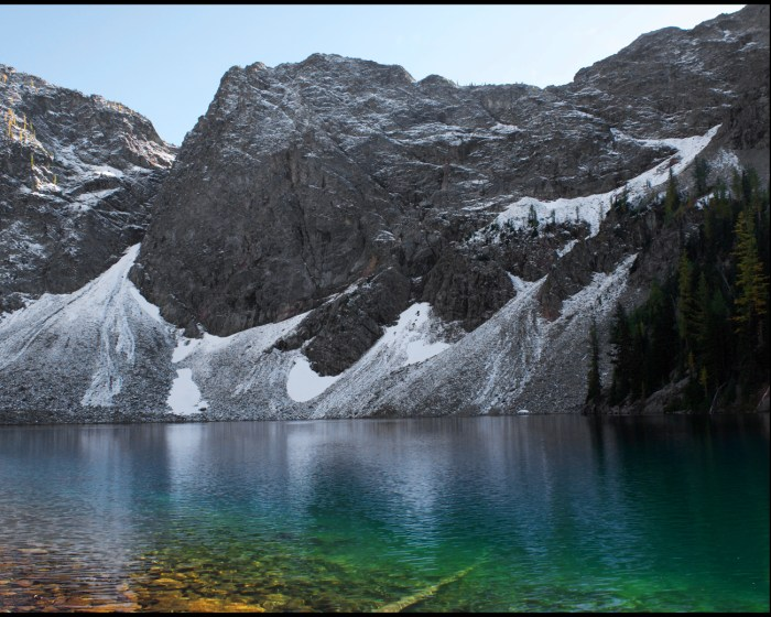 Close-up of Blue Lake with blue-green waters, mountain walls, and glaciers at the foot of the mountains