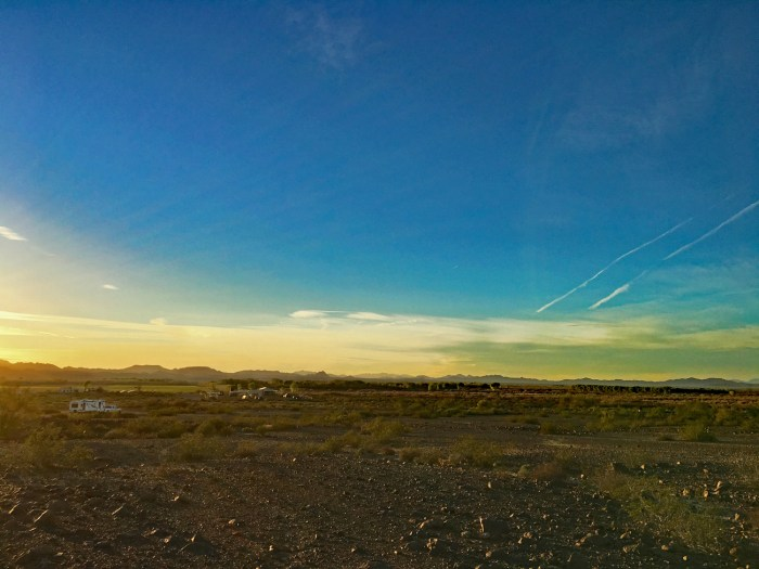 View of our campsite with Cibola NWR across the road, and mountains in the sunset in the distance