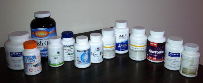 The bottles of all the pills I was popping on the SIBO Center herbal protocol