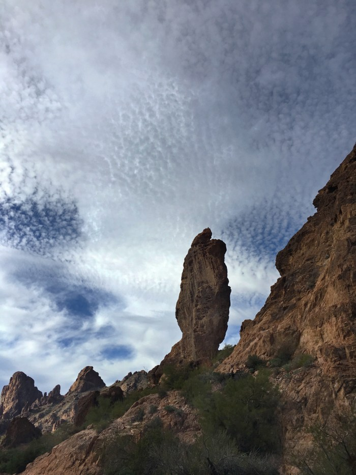 Balanced rock with intensely patterned sky behind it at Kofa Queen Canyon