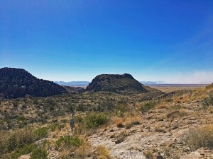 View from the top of Natural Bridge Trail, looking out over some of the pinnacles and out into the expansive grasslands and mountain ranges of southeastern Arizona