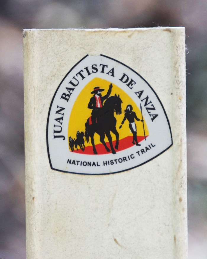 Trail marker with the Juan Bautista De Anza National Historic Trail sticker