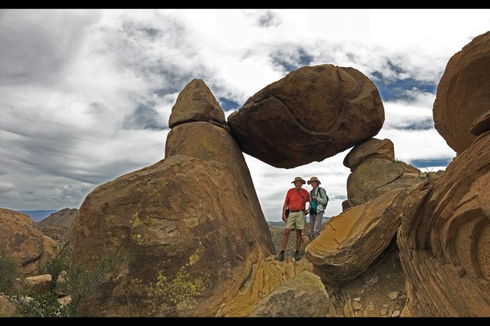 David and Christina standing under Balanced Rock on top of Grapevine Hills at Big Bend National Park