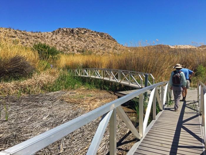 David (Christina's Dad) and Christina crossing a bridge on the Rio Grande Village Nature Trail