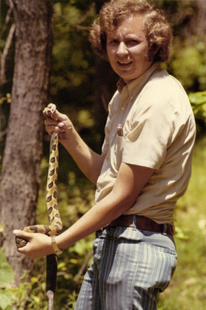 My dad, as a young man, holding a timber rattlesnake
