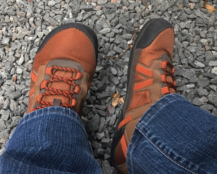 Looking down at my feet while sitting, wearing my Daylite Hikers by Xero Shoes