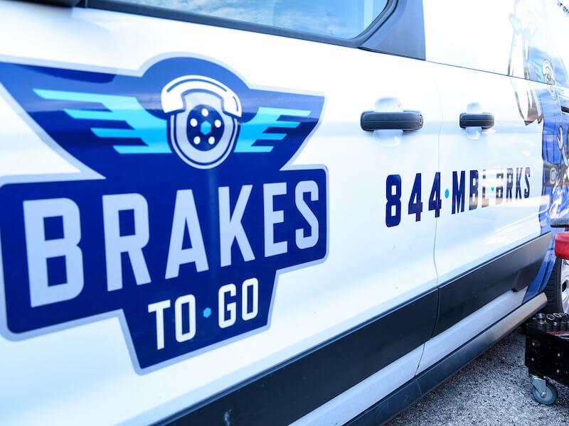 Brakes To Go logo on displayed on vehicle during a brake repair