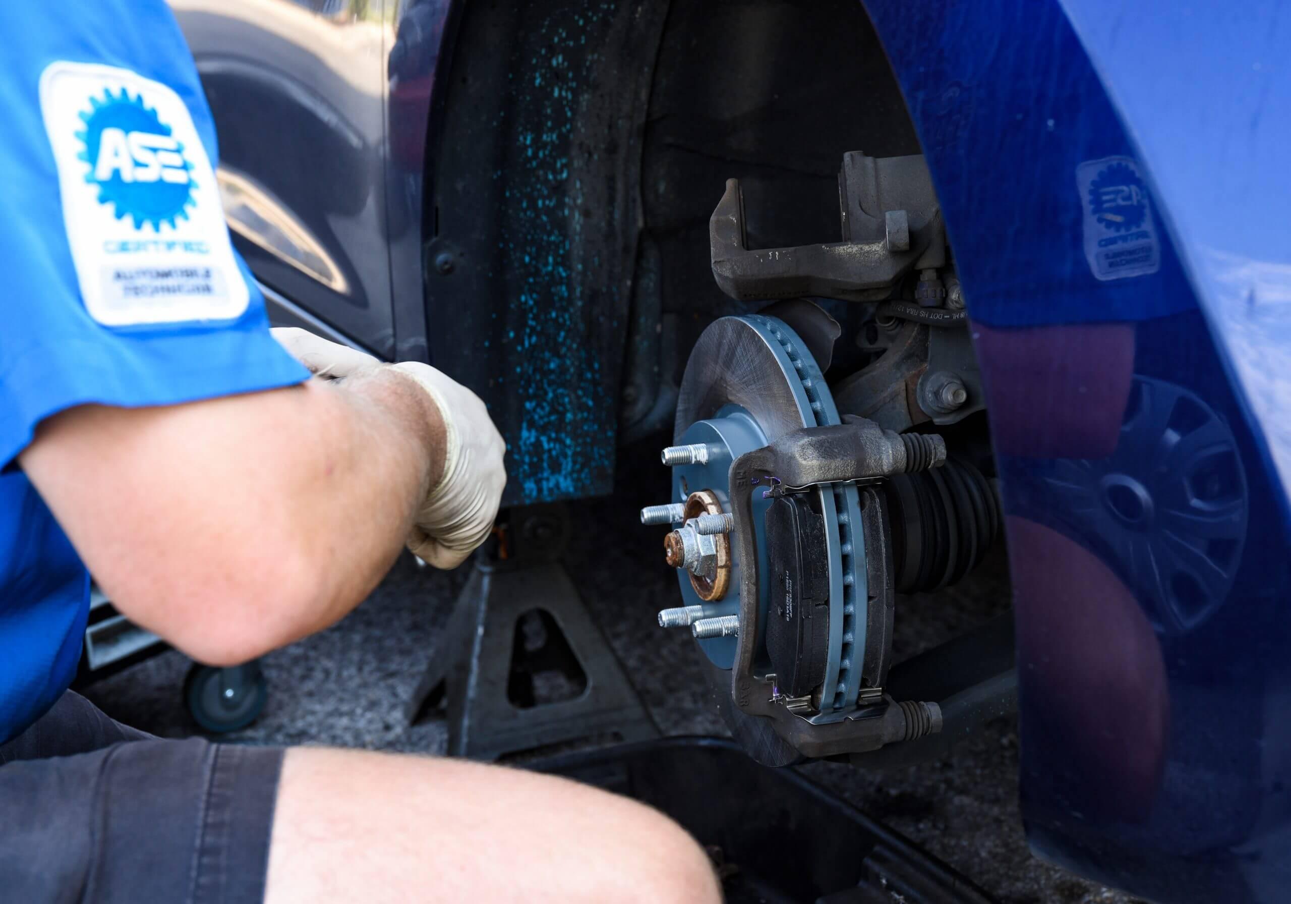 ASE Technician working on brake repair