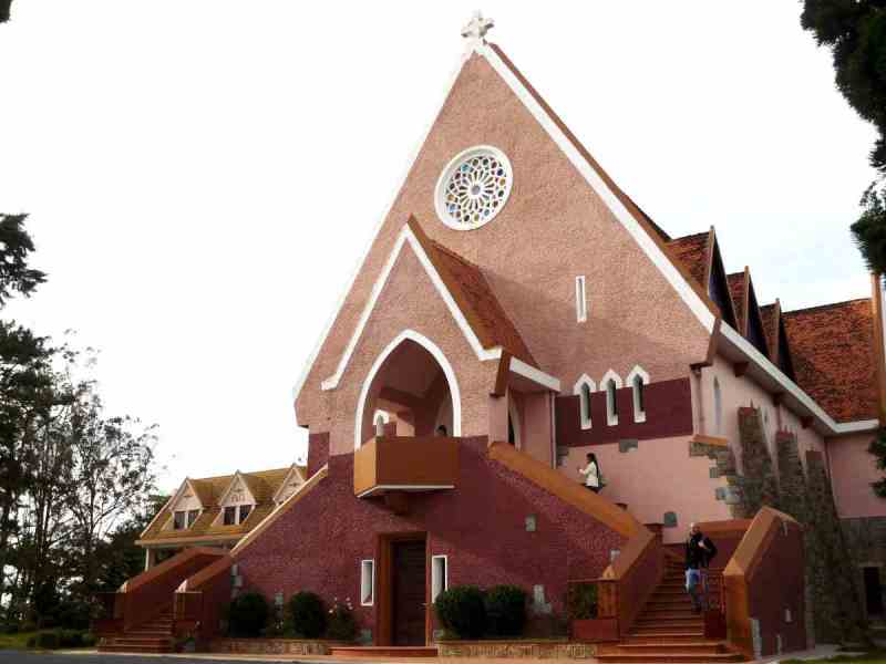 Nha Tho Domaine de Marie, a pink church on top of a hill in Da Lat