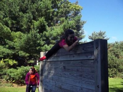 student climbing a wall