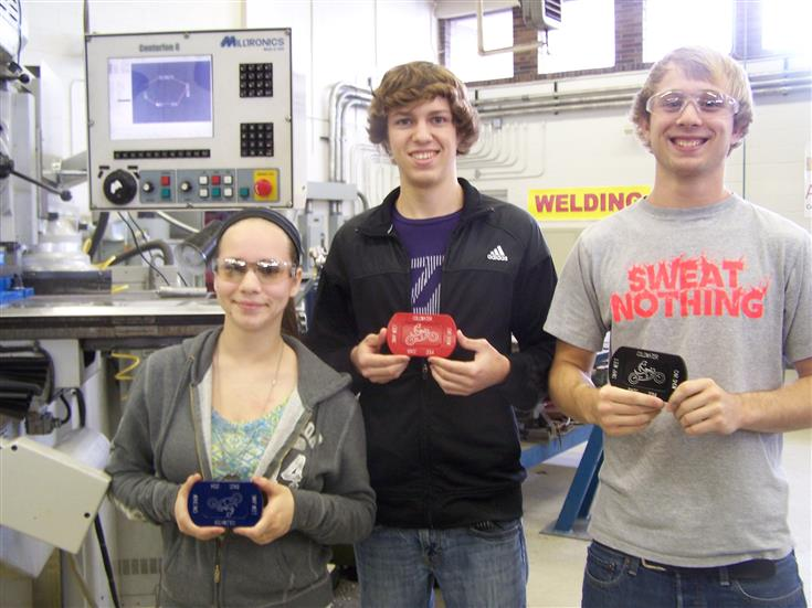 3 students showing machined parts