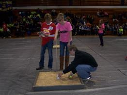 student measuring at a competiton