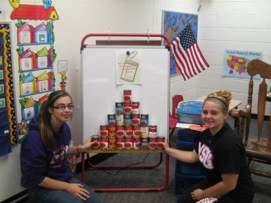 Students posing with canned food