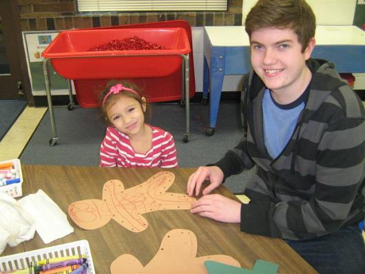 HS and Preschool student working on art project